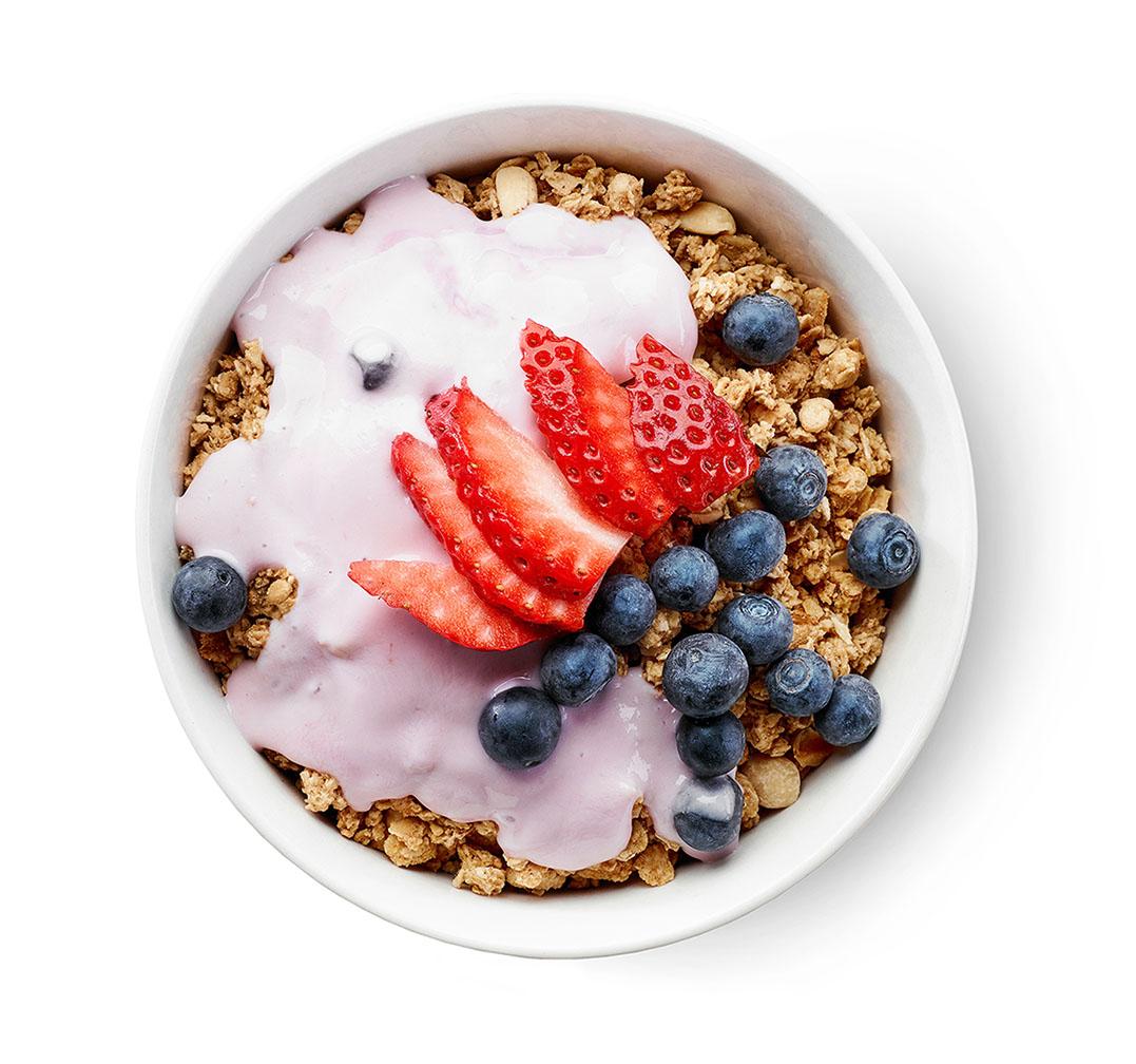bowl of granola with yogurt and berries